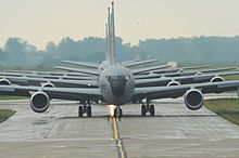 The front of several gray aircraft are centered in the image.