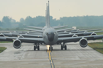 Boeing KC-135 Stratotanker - A nose-on view of several reworked KC-135R aircraft taxiing prior to takeoff. The new engines are CFM56-2 high-bypass turbofans.