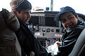 Kandahar area students listen to a description of the different controls in the cockpit of an Afghan air force plane during the Kandahar Air Wing's third annual open house, in Kandahar province, Afghanistan 120101-A-EL067-004.jpg