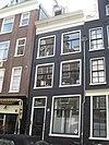 foto van Ouder huis met latere gevel onder rechte lijst met dakkapel