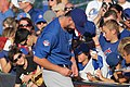 Kris Bryant signing autographs during his rehab assignment against Omaha (44315151331).jpg