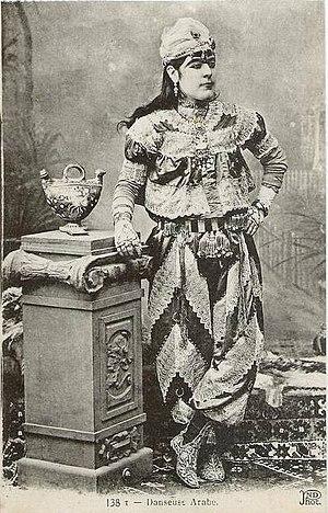 Köçek - Postcard photograph of a köçek posing in costume, late 19th-century.