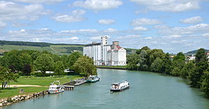 Marne (river) - The Marne at Dormans, showing aspects of the navigation in the 21st century: grain silos, generating the principal commercial traffic, a hotel barge, and recreational craft