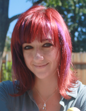 Lauren Faust - Faust in 2014 with Super Best Friends Forever figures