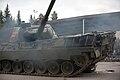 Leopard 1 rolls over a car.jpg
