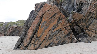Lewisian complex suite of Precambrian metamorphic rocks that outcrop in the northwestern part of Scotland