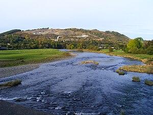 Llanelwedd - Llanelwedd quarries from the bridge across the River Wye