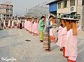 Locals Offering rice to Bhikkhunī (March 2020).jpg