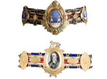 both versions of the Lonsdale Belt, the first one above the second, imposed on a clear white background