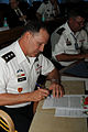 Lt. Gen. Benjamin R. Mixon signs the meeting minutes at the 14th Executive Steering Group in Chandigarh.jpg