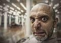 Man pulling face at camera (8455760157).jpg