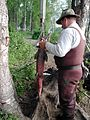 Man weighs king salmon fish.jpg