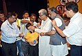 Manik Sarkar and the Minister of State for Social Justice & Empowerment, Shri Krishan Pal at the distribution camp of the aids and assistive devices to the persons with disabilities (Divyangjan), in Agartala, Tripura.jpg