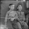 Manzanar Relocation Center, Manzanar, California. Two small evacuees of Japanese descent at Memoria . . . - NARA - 538546.tif