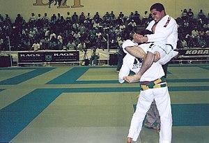 Triangle choke - Brazilian Jiu-Jitsu Black Belt Marcos Torregrosa landing a flying triangle choke.