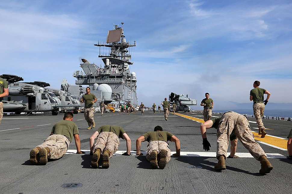Marines conduct physical training aboard USS Makin