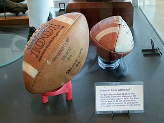 Marshall Faulk - Marshall Faulk's game ball from the September 14, 1991 game when he ran for a NCAA-record 386 yards and scored 44 points in his second game as a true freshman for San Diego State