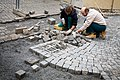 Masons laying Cobblestones in the street, Prague - 9254.jpg