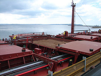 Oil tanker - The OBO-carrier Maya. The picture is showing both the cargo hold hatches used for bulk and the pipes used for oil