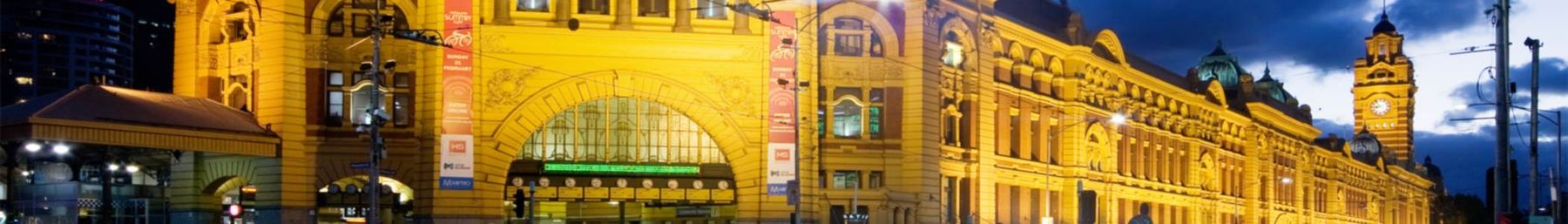 Flinders Street Station in the City Centre by dusk