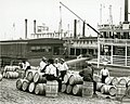 Men at work among barrels on the St. Louis Levee.jpg