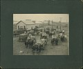 Men on wagons bringing crops to market with photo gallery in background (8451690712).jpg