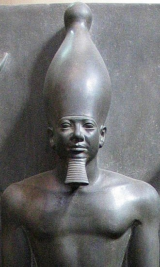 Menkaure - Greywacke statue of Menkaure, Egyptian Museum, Cairo.
