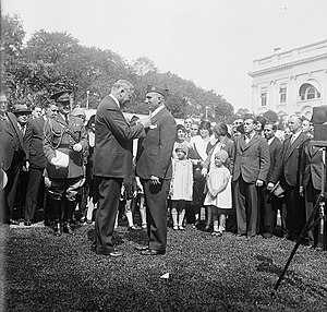 Michael Valente - Original caption:  President Hoover presents Congressional Medal of Honor to World War hero.  Michael Valente, formerly Private, Company D, 107th Infantry, 27th Division during the World War, receiving from President Hoover the Congressional Medal of Honor at the White House today.  Valente receives the medal for bravery while in Hindenberg Line during the World War.  He enlisted at Ogdensburg, N.Y., but is now a resident of Long Beach, N.Y.