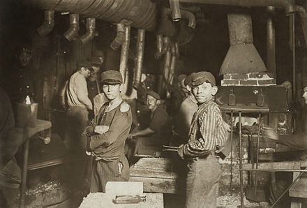 Child laborers in glassworks, by Lewis Hine. Indiana, August 1908. Midnight at the glassworks2b.jpg