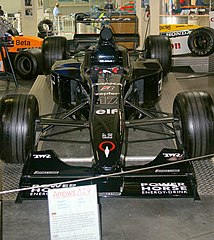 5ba561c087 In 1998 Arrows switched from a white and blue livery to a black one. This