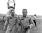 Mike Collins (left) and Deke Slayton walking from T-38 aircraft at Patrick AFB.jpg