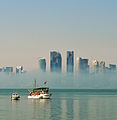 Mist burning off Doha Bay (12544429115).jpg