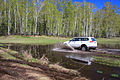 Mitsubishi Pajero Sport runs through spring puddle 04.JPG