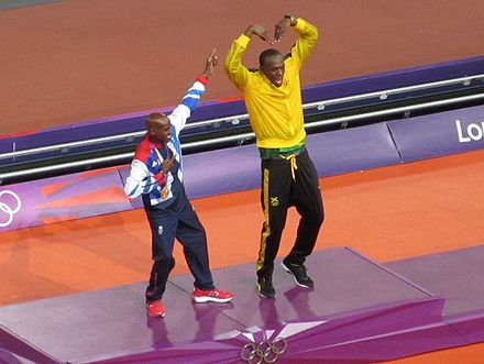 Mo Farah with Usain Bolt. Mo Farah and Usain Bolt 2012 Olympics (cropped).jpg