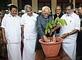 Mohammad Hamid Ansari planting a sapling on the occasion of the 125th Anniversary Celebrations of the Legislative bodies in Kerala, in Thiruvananthapuram, Kerala. The Governor of Kerala, Shri Nikhil Kumar.jpg