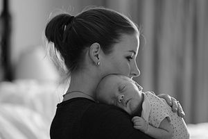 Parenting styles - Mother carrying an infant child