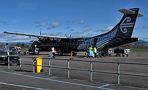 Cyathea dealbata - An Air New Zealand ATR 72-600 with a stylised koru on the tail and otherwise painted in all black livery with a silver fern on the fuselage.