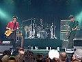 Muse at Roskilde Festival 2000 (4688235761).jpg