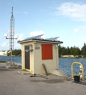 Weather station - The NOAA weather station at Wake Island harbor measures and transmits data on wind speed, atmospheric pressure, air temperature and tides.