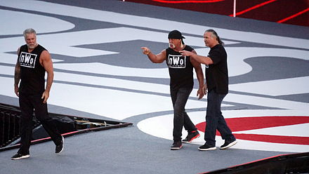 Nash (left) at WrestleMania 31 in 2015, alongside Hulk Hogan (middle) and Scott Hall (right), as the nWo NWo WM31.jpg