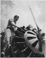NYA-work experience in aviation for NYA boys-Youth Gets a Break-two men working on propeller section of plane - NARA - 195861.tif