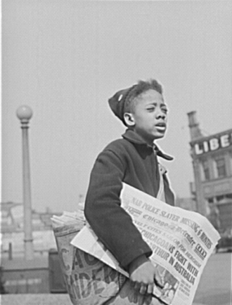 African-American newspapers - Newsboy selling the Chicago Defender, April 1942