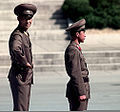 North Korean guards stand at their post providing protection for a group of people touring North Korean side of the Demarkation line 981008-F-CP197-509.jpg