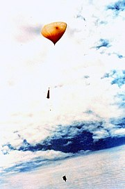 A NOAA weather balloon just after launch.