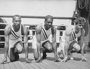 Ralph Metcalfe - Metcalfe (center) with Jesse Owens and Frank Wykoff on the deck of the S. S. Manhattan as the team sailed for Germany in 1936