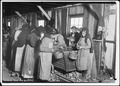 On right hand end is Marie Colbeck, 8 years old, who shucks 6 or 7 pots of oysters a day (30 or 35 (cents)) at... - NARA - 523396.tif