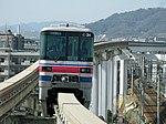 Osaka Monorail 1624 at Hotarugaike Station.jpg