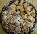 Pastries covered by plastic wrap at a party.JPG