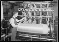 Paterson, New Jersey - Textiles. The completed warp. The operator is shown untying the sections of the warp from the... - NARA - 518556.tif