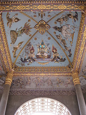 Patuxai - Interior decoration with depictions of the gods Vishnu, Brahma, and Indra from left to right